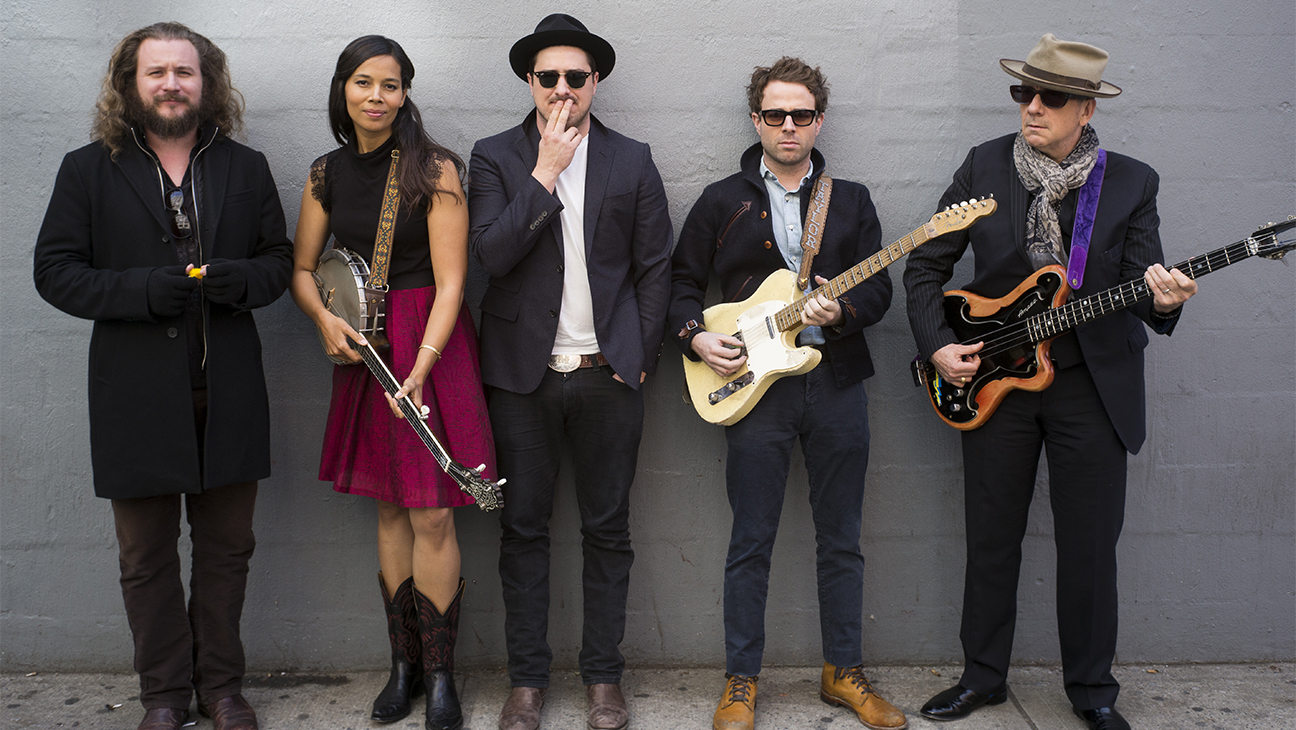 "This Nov. 9, 2014 photo shows, from left, Jim James, Rhiannon Giddens, Marcus Mumford, Taylor Goldsmith and Elvis Costello posing in in New York in promotion of ""Lost on the River: The New Basement Tapes,"" an album produced by T Bone Burnett and created by the musicians using lyrics written by Bob Dylan for the legendary ""basement tapes"" recordings. (Photo by Drew Gurian/Invision/AP)"